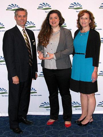 Hallie Foster (Center) receives award presented by Alan Morgan (left) and Lisa Kilawee (right).